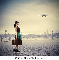 Classy traveller - Woman classy traveller walks in a square