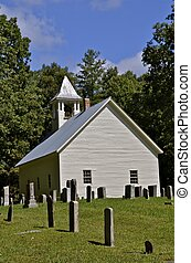 Old white church and graveyard - A graveyard of early...