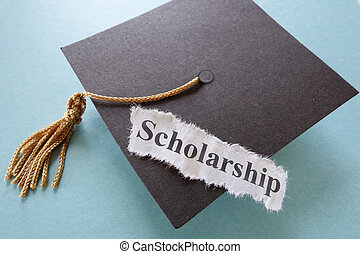 scholarship - Scholarship paper note on a graduation cap...