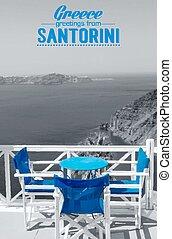 Table on terrace overlooking sea in Oia, Santorini,...