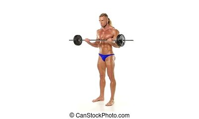 Portrait of strained athlete bodybuilder lifting rod on a...