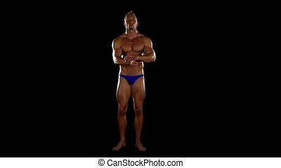 Bodybuilder posing over black background.