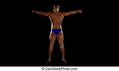 Bodybuilder posing over black background