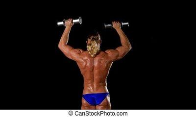 Man makes exercises dumbbells. Sport, power, dumbbells,...
