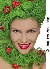 Woman with green hair and strawberries on them isolated on...