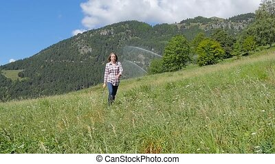 beautiful farm girl with pitchfork - cute girl walking in...