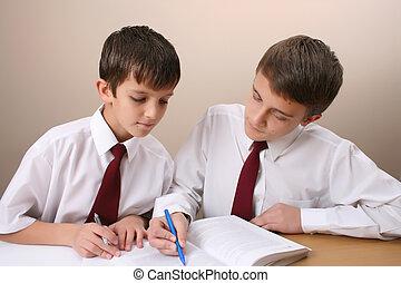 School Boys - Teenage School boys busy with his homework,...