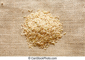 Brown rice on a textile background