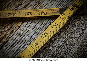 Old Tape Measure on Rustic Wood Background - Old Tape...