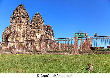Prang Sam Yot - Monkey in front of Prang Sam Yot in Lopburi,...