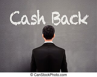 businessman with cash back words over grey background