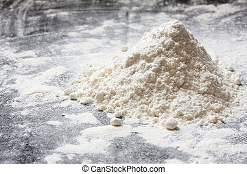Flour in a heap on a kitchen top