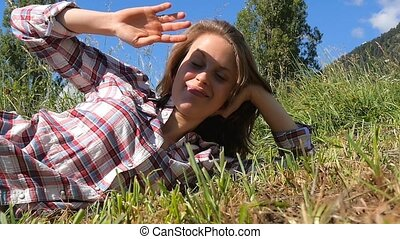 blond romantic girl relaxing - young farm girl lying in a...