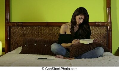 Woman Girl Reading Book On Bed - Young woman annoyed after...