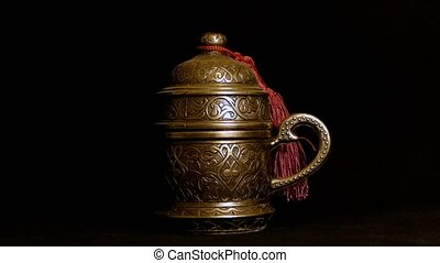 Turkish coffee cup in a metal coaster on back Light source...