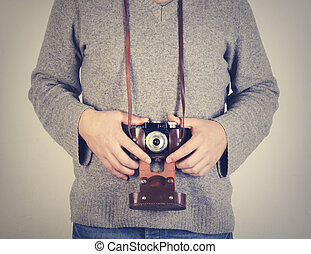 Man holiding retro camera - Man holding retro camera