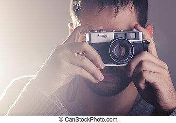 Man holiding retro camera - Man holding retro camera