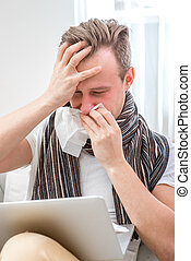 Man catching cold - Ill man suffering from rhinitis sitting...