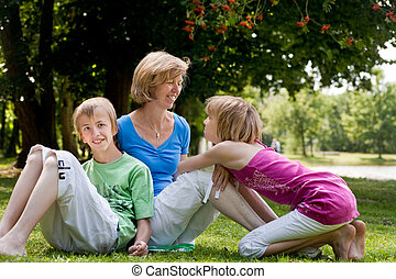 Daugther wants to ask something - Happy family enjoying...