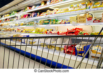 shopping cart in front of cooling shelf with dairy products
