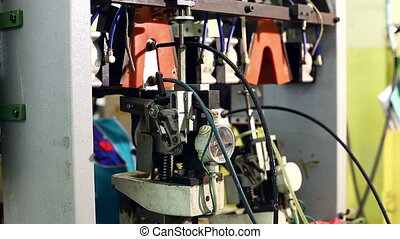 Worker controls machine on production floor