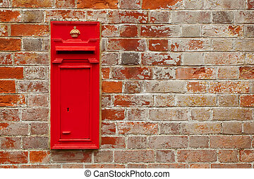 mail box - traditional british mail box against a red brick...