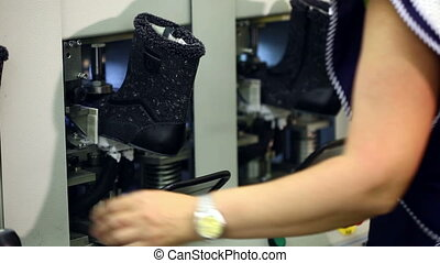 Working woman checks workpiece boots, close-up - Working...