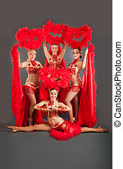 young beautiful girls dancers in red dresses - four young...