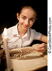 Young girl smiling with book at library