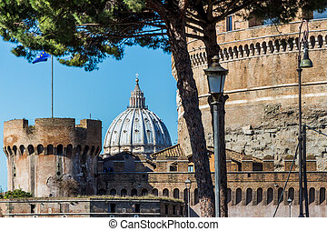 italy, rome, castel sant angelo with st peters basilica in...
