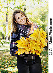 happy woman in the autumn park