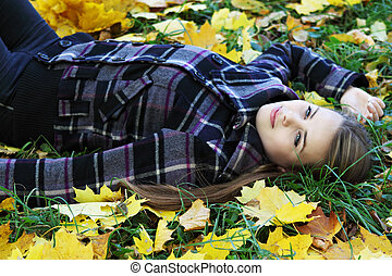woman on the autumn lawn