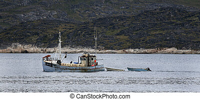 Fishing boat sailing in the high arctic