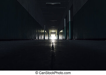 dark corridor with light in horizon