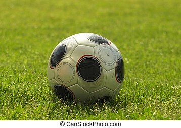 Soccer ball in playing field - Close-up of soccer ball in...