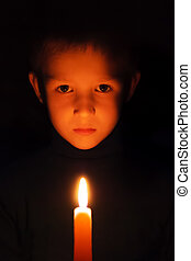 turning off lights - boy with burning wax candles in their...