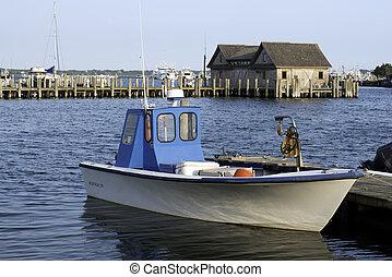 fishing boat in bay harbor marina Montauk New York USA the...