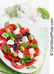 salad with tomato goat cheese and olives