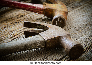 Old Hammers on Rustic Wood Background