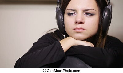 Girl bored - Sitting on chair with headphones girl bored