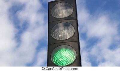 Traffic Light Changing to Red - Traffic lights turning green...