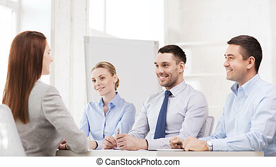 smiling businesswoman at interview in office - business,...