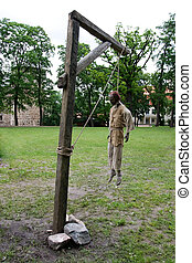 Hanged man in gallows - Manikin of dead man hanging from...