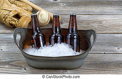 Beer on ice for baseball - Front view of three brown bottled...