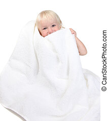 Adorable Happy Baby Boy Holding Towel to His Face Smiling