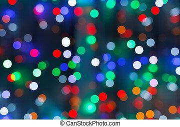 defocused christmas lights in dark night