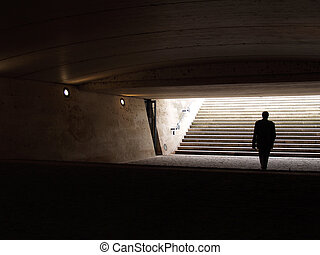 Alone - Man walking in the underpass