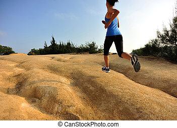 young woman runner legs running - young woman runner legs...