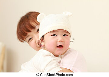 mom and baby - portrait of a happy young Japanese mom and...