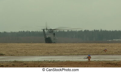 Military helicopter flies through runway - View of military...